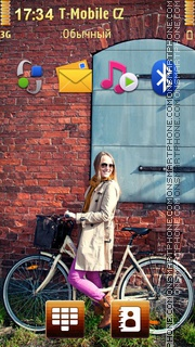 Smiling Blonde Girl Riding Bicycle theme screenshot