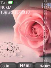 Pink rose with clock es el tema de pantalla