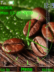 Coffee grains on a green leaf tema screenshot
